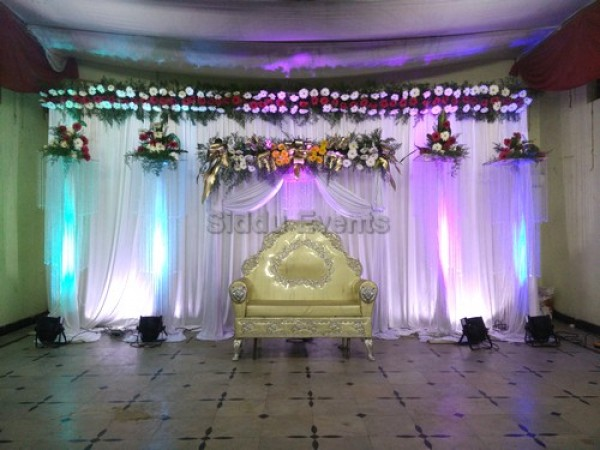 White Backdrop Decoration For Naming Ceremony